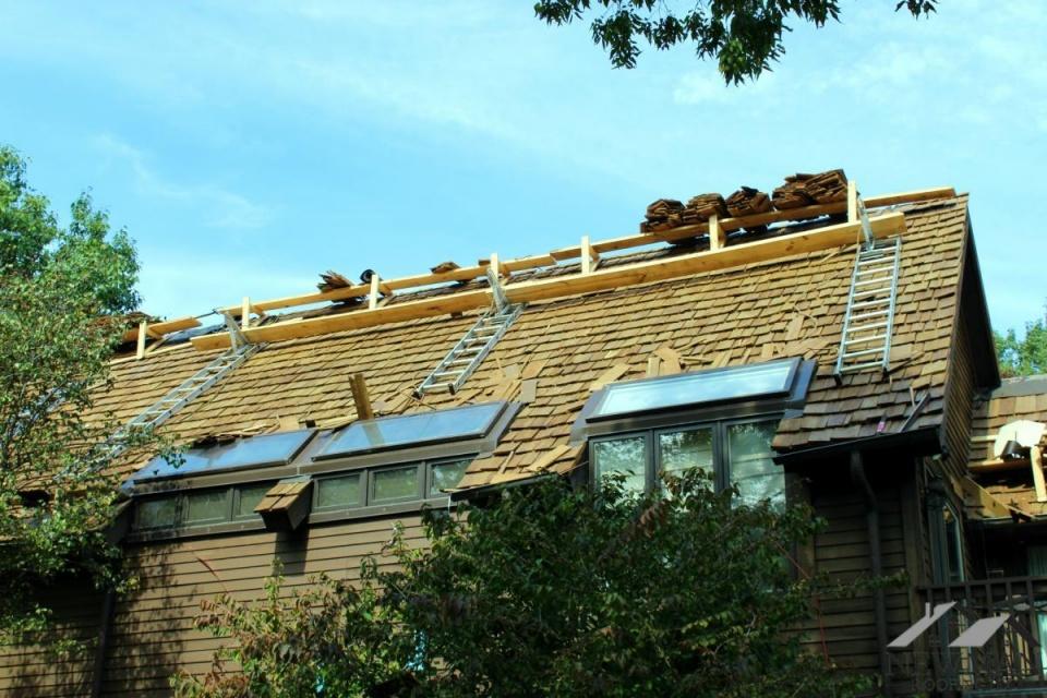 Working on Warped Cedar shakes Roof-11111111111.jpg