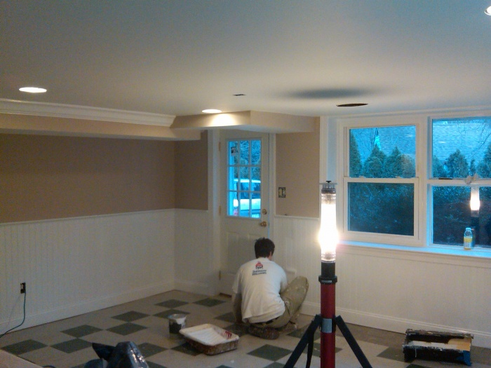 I installed this wainscoting, crown molding, window trim, drywall, and door, and painted it. Then I took a picture with a low mega pixel camera on my phone.